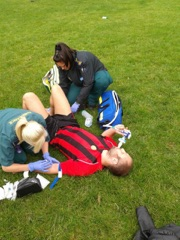 Paramedics tending to my broken leg