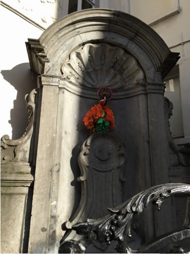 Manneken Pis all dressed up in one of his many costumes