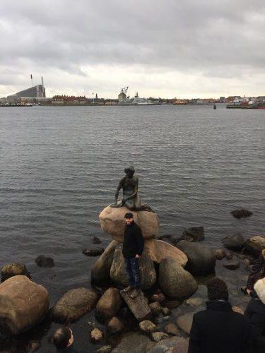 Little Mermaid sculpture is displayed on a rock by the waterside at the Langelinie promenade in Copenhagen.
