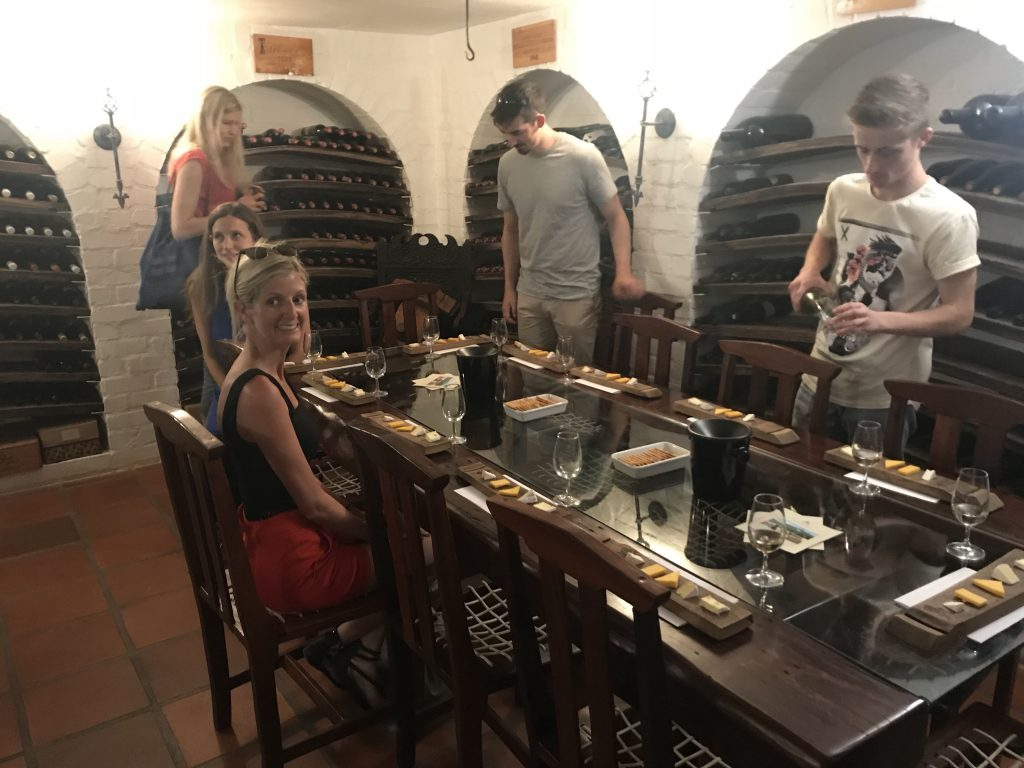 Wine and cheese in the luxurious cellar at Mitre's Edge Boutique Winery