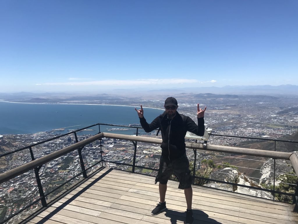 Me looking terrified as I look out on the views to Cape Town from the mountain top viewing platform.